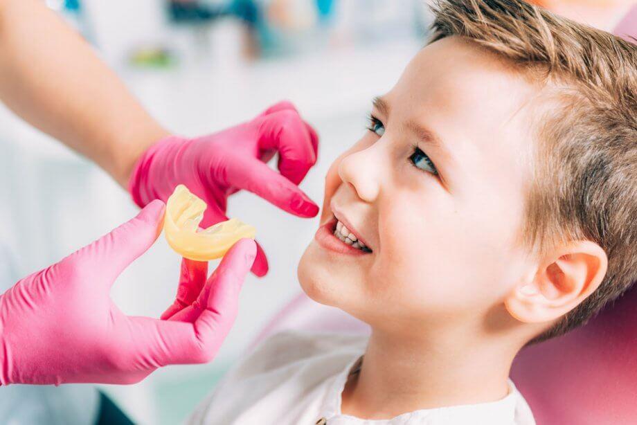 boy in dental chair having dental impressions taken
