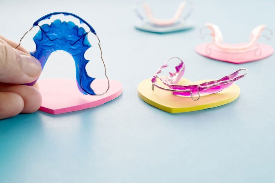 display of different colored orthodontic retainers