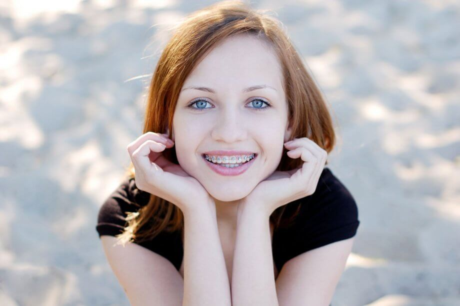 teen girl with braces smiling
